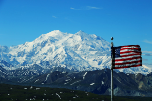 Accessibility equals a colorful world. Color Photo of Flag in front of Mountains