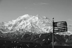 Inaccessibility Equals a Black and White world. Black and White photo of flag in front of mountain
