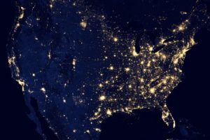 Picture of the US from Space in Darkness with the cities brightly illuminated reminding us that the Darkness of Inaccessibility is Highlighted by the Brightness of Accessibility.