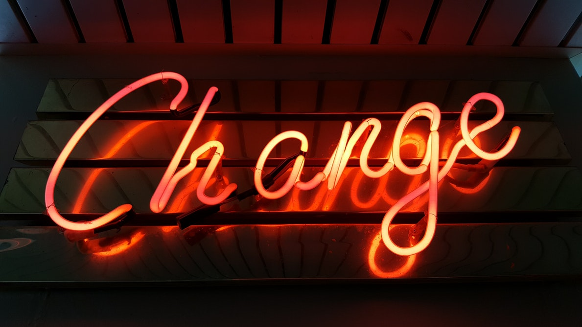 Change can be a scary thing. These orange neon letters on a dark background spelling out change, reminds us that without change, there would be no civil rights.