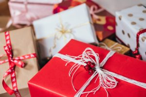A Pile of Co;orfully Wrapped Gifts - red, white, burgundy